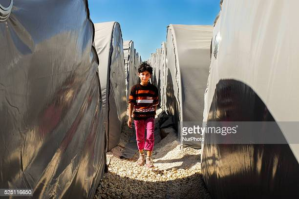 A kurdish refugge girls walks througt the tents in a refugge camp in the Turkish city of Suruc Sanliurfa province wich is located 6 kilometres far...