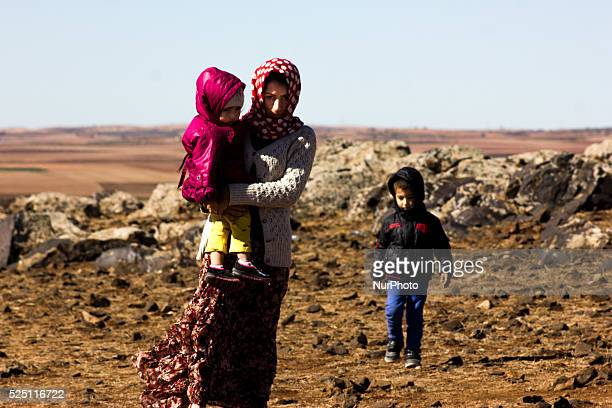 A Kurdish refugge woman with her children in the hill in the Turkish city of Suruc Sanliurfa province wich is located 6 kilometres far from the...