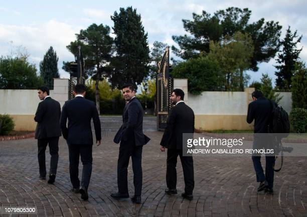 Kurdish security members walk through the Presidential compound during a visit by US secretary of State Mike Pompeo in Erbil in the Kurdish...