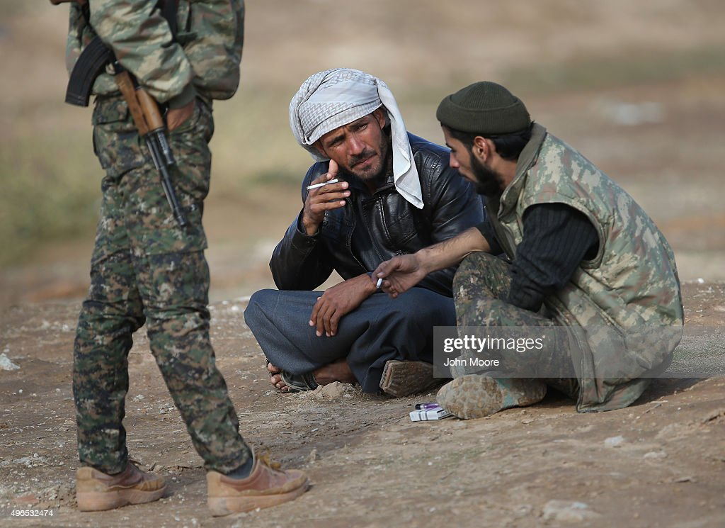 Kurdish soldiers from the Syrian Democratic Forces take a break from frontline action at a forward operating base on November 10, 2015 near the ISIL-held town of Hole in the autonomous region of Rojava, Syria. The coalition of forces, primarily Kurdish, are attacking ISIL extremists in the area near the Iraqi border and calling in airstrikes from U.S.-led coaltion warplanes. The autonomous region of Rojava in northern Syria has become a bulwark against the Islamic State. The Rojava armed forces, with the aid of U.S. airstrikes and weapons, are retaking territory which had earlier been captured much by ISIL from the Syrian regime.
