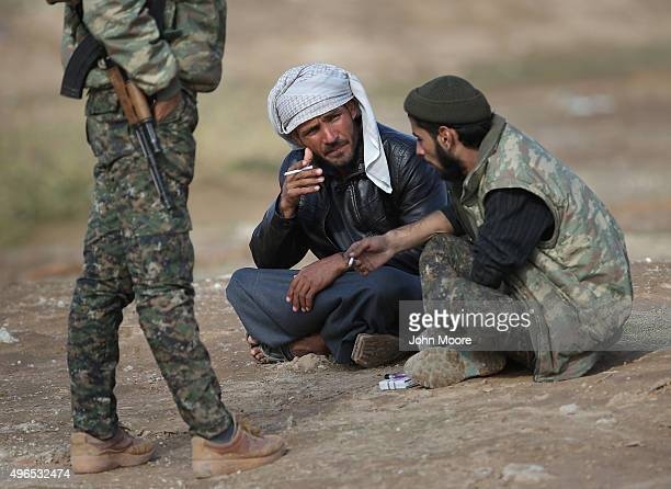 Kurdish soldiers from the Syrian Democratic Forces take a break from frontline action at a forward operating base on November 10 2015 near the...