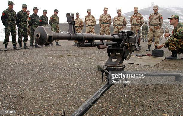 Kurdish soldiers learn how to use a gun at a military exercise January 29, 2003 in the Suran Valley which is located in North Iraq. Kurdish General,...