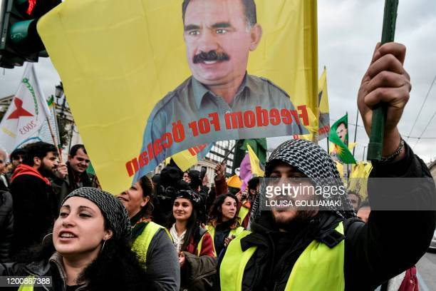 Kurdish supporters of convicted Kurdistan Worker's Party leader Abdullah Ocalan chant slogans and wave flags depicting Ocalan in central Athens after...