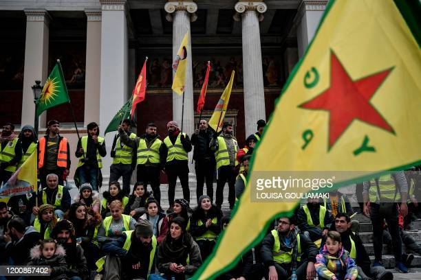 Kurdish supporters of convicted Kurdistan Worker's Party leader Abdullah Ocalan chant slogans and wave flags in central Athens after marching for two...