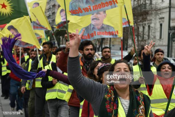 Kurdish supporters of convicted Kurdistan Worker's Party leader Abdullah Ocalan flash the Victory sign as some hold flags depicting Ocalan in central...
