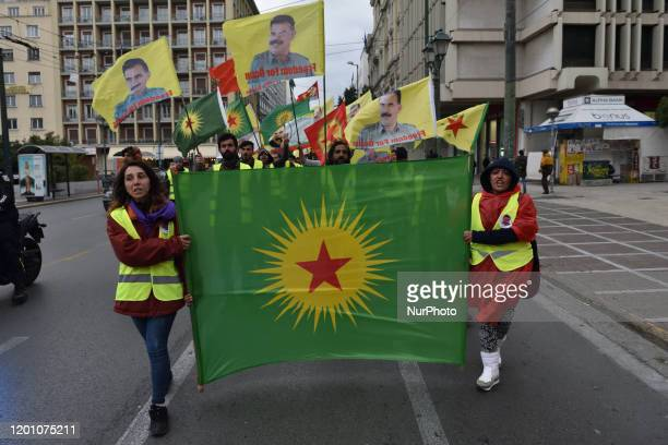 Kurdish supporters of convicted Kurdistan Worker's Party leader Abdullah Ocalan wave flags depicting Ocalan as they gather in central Athens after...