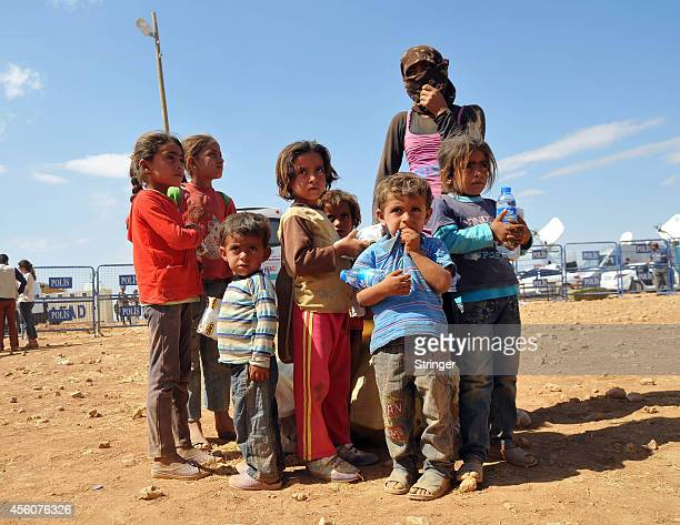 Kurdish Syrian refugees camp at the TurkishSyrian border near the southeastern town of Suruc in Sanliurfa province September 25 2014 Nearly 140000...