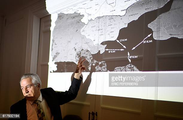Kurdish Syrian representative in France Khaled Issa shows a map of alleged attacks against Kurdish forces as he accuses Turkey of 'massively...