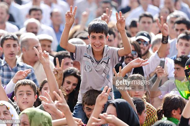 Kurdish teenager boy making peace sign