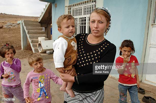 Kurdish village guard Bahri Eren's wife Hazine and her family pose in their village of Yoruk against PKK attacks on civilians near the southeastern...