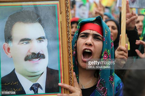 A Kurdish woman chants slogans on March 14 as she carries a portrait of jailed Kurdish rebel chief Abdullah Ocalan during a demonstration in the...