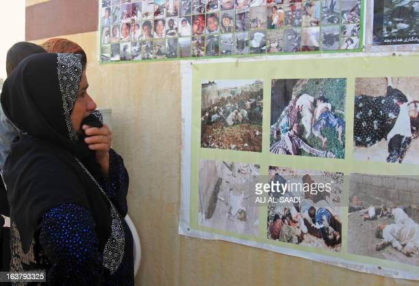 A Kurdish woman cries as she looks at pictures of victims of a gas attack by former Iraqi president Saddam Hussein in 1988 at the memorial site of...