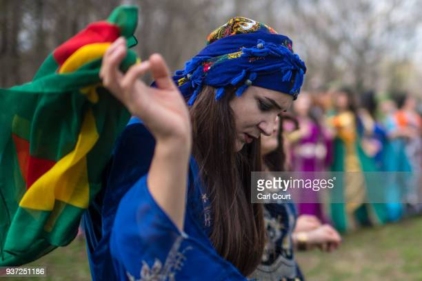 Kurdish woman dances during Nowruz celebrations on March 24 2018 in Tokyo Japan Nowruz meaning 'new day' and marking the first day of spring is...