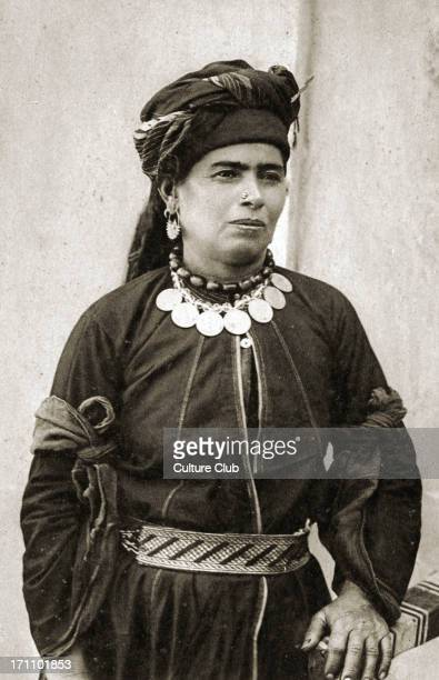 Kurdish woman in her best costume of black Persian silk with silver belt and her necklace of amber beads with Turkish coins attached Kurd Kurdistan...