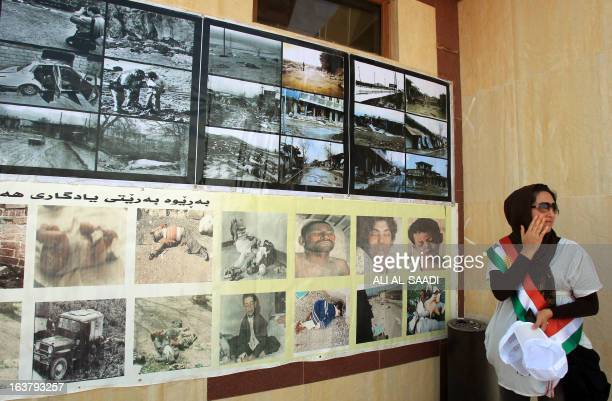 Kurdish woman turns away as she looks at pictures of victims of a gas attack by former Iraqi president Saddam Hussein in 1988, at the memorial site...
