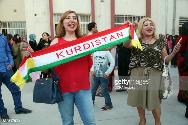 Kurdish women are pictured while hodling a kurdistan scarf during the referendum September 25 2017 is a historic day for Kurdish people around the...