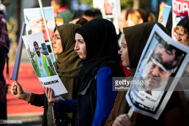 Kurdish women attend a demostration 'Erdogan not welcome' to protest against the visit of Turkish President Recep Tayyip Erdogan in Berlin, Germany...