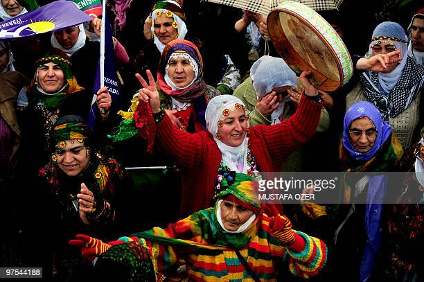 Kurdish women dance and shout slogans during a demonstration to mark the International Women's Day scheduled on March 8 in the Asian side of Istanbul...