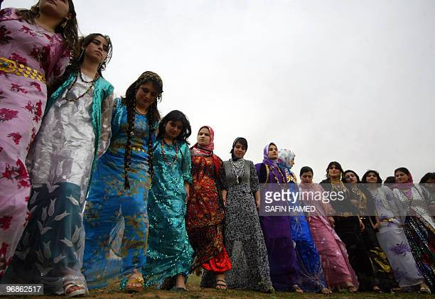 Kurdish women dance during a traditional wedding ceremony in the Kurdish city of Arbil northern Iraq on February 18 2010 AFP PHOTO/SAFIN HAMED