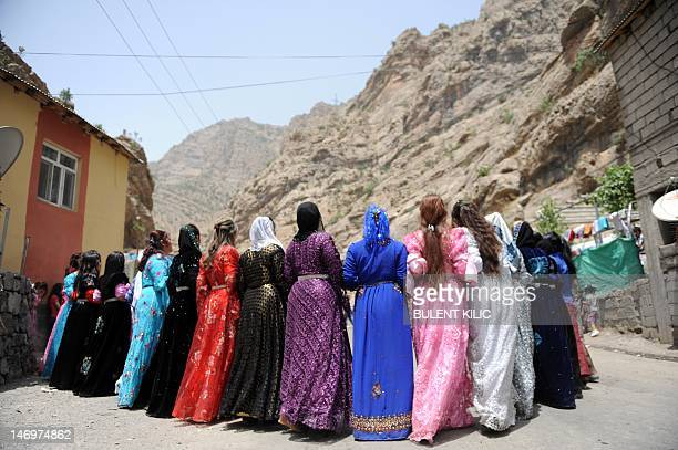 Kurdish women dance during a wedding ceremony at Yekmal village in the mountains of Hakkari on June 24 2012 Hakkari is a province situated in the...