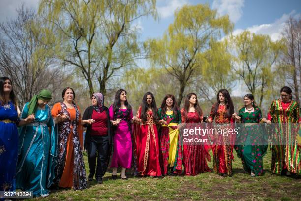 Kurdish women dance during Nowruz celebrations on March 24 2018 in Tokyo Japan Nowruz meaning 'new day' and marking the first day of spring is widely...