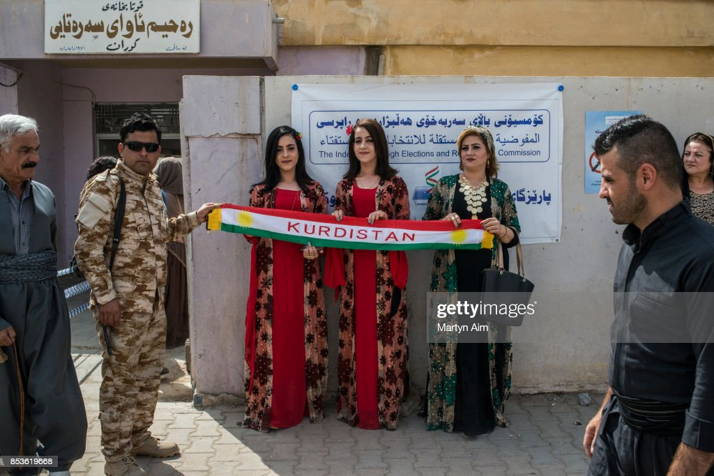 Kurdish women hold a banner at a referendum to decide on independence from Iraq and the establishment of Kurdistan as a state on September 25, 2017 in Kirkuk, Iraq. Despite strong objection from neighboring countries and the Iraqi government. Some five million Kurds took to the polls today across three provinces in the historic independence referendum.
