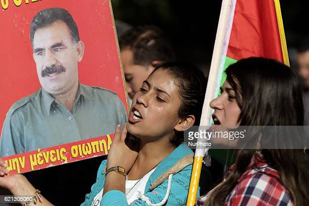 Kurdish women hold a photo of PKK leader Abdullah Ocalan taking part to a protest rally against the Turkish government at Syntagma square central...