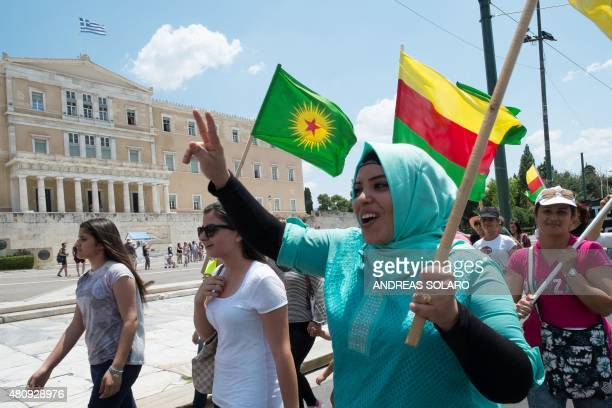 Kurdish women hold flags of Rojava and KCK as they demonstrate in front of the Greek parliament in Athens on July 16 2015 The United States does not...