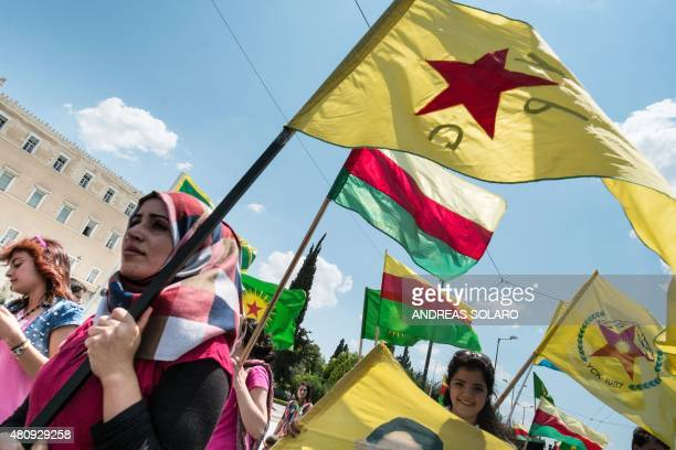 Kurdish women hold flags of YPG and Rojava as they demonstrate in front of the Greek parliament in Athens on July 16 2015 The United States does not...