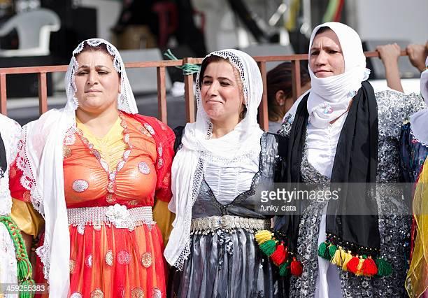 Kurdish women in traditional dress dancing (Halay)