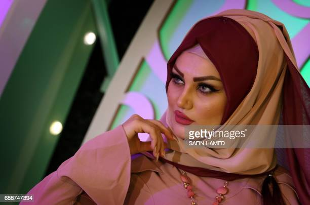 A Kurdish women walks down the runway during a Ramadan show for veiled women clothing in Arbil the capital of the Kurdish autonomous region in...
