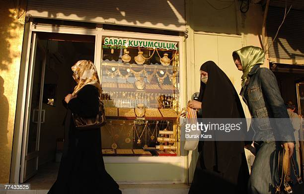 Kurdish women with traditional black chadors shop in the central bazaar on October 21 2007 in the Iraqi border Turkish town of Cizre Turkey Kurds in...