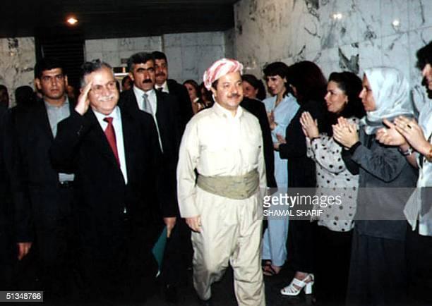 Kurdistan Democratic Party chief Massoud Barzani and Patriotic Union of Kurdistan leader Jalal Talabani head to a parliament meeting 04 October 2002...