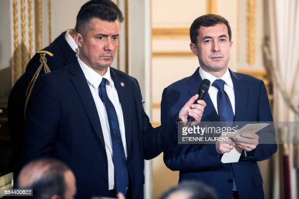 Kurdistan Government representative in France Ali Dolamari delivers a translation as some issues are faced during a joint press conference by the...