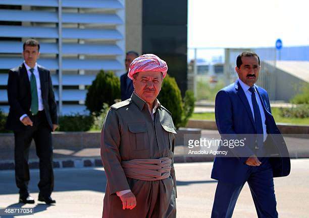 Kurdistan Regional Government President Masoud Barzani waits for the arrival of Iraqi Prime Minister Haidar al-Abadi during a welcoming ceremony at...