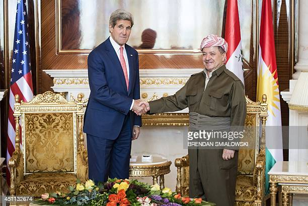 Kurdistan regional government president Massud Barzani greets US Secretary of State John Kerry at the presidential palace in Arbil the capital of...