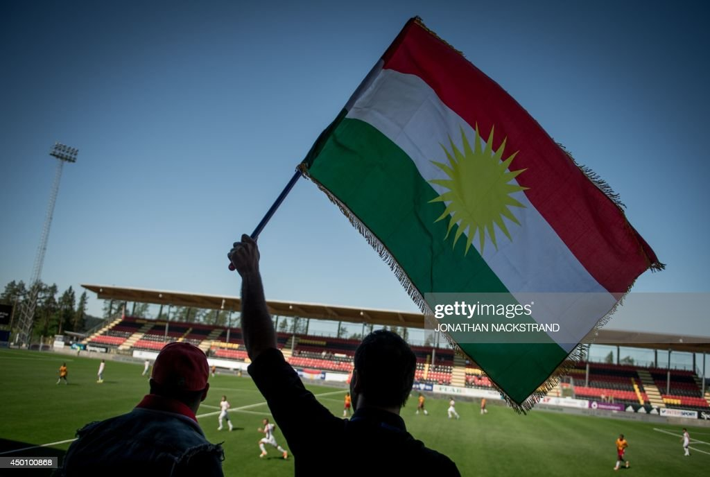 Kurdistan's supporters hold Kurdistan's flag and cheer their team during the CONIFA (Confederation of Independent Football) World Football Cup 2014 match between Tamil Eelam and Kurdistan on June 3, 2014 in Oestersund, Sweden. 12 teams with large refugee diaspora from four continents, including Tamils, Kurds, Sami and Occitanians, compete in Oestersund in one of the world's largest tournaments for stateless or indigenous people, regions seeking autonomy and other non-FIFA affiliated teams.