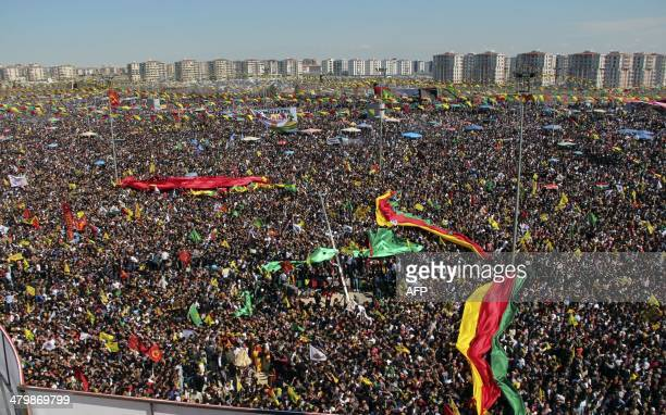 Kurds carry flags and pictures of jailed Kurdish rebel leader Abdullah Ocalan as they gather to celebrate Newroz the Kurdish New Year on March 21...