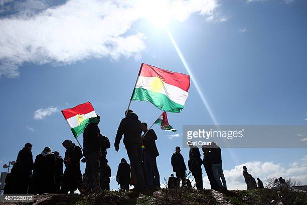 Kurds from Turkey and Syria celebrate hold up Kurdistan flags as they celebrate Kurdish New Year on March 21 2015 in Diyarbakir Turkey Diyarbakir has...