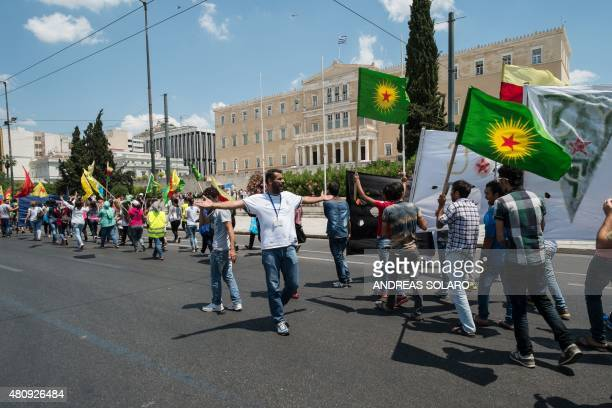 Kurds hold flags of KCK as they demonstrate in front of the Greek parliament in Athens on July 16 2015 The United States does not support the...