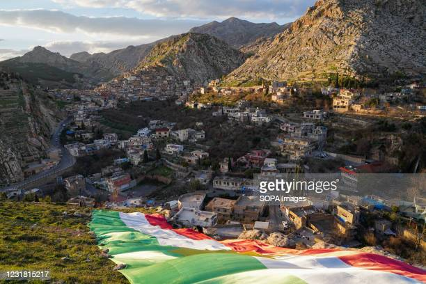 Kurds place a flag of Kurdistan over one of the mountains in the Old town of Akre. The town of Akre in the Duhok governorate is preparing to...