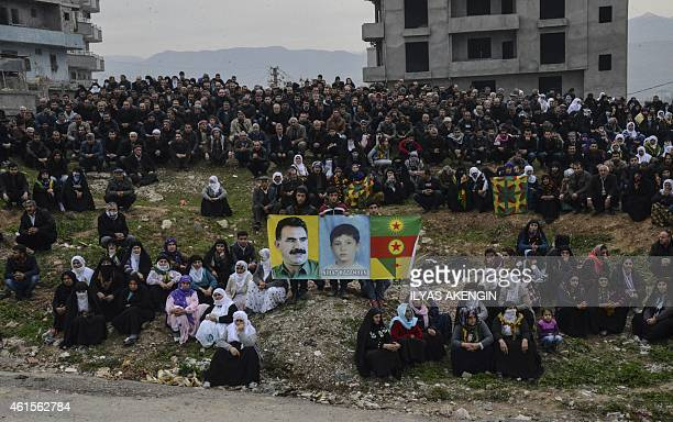 Kurds pose on January 15 2015 with pictures of 12yearold boy Nihat Kazanhan who was allegedly shot dead by police in the Cizre district of Sirnak on...