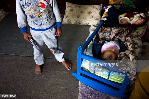 Kurds refugee children live with their family in an abandoned gas station in the Turkish city of Suruc Sanliurfa province wich is located 6...