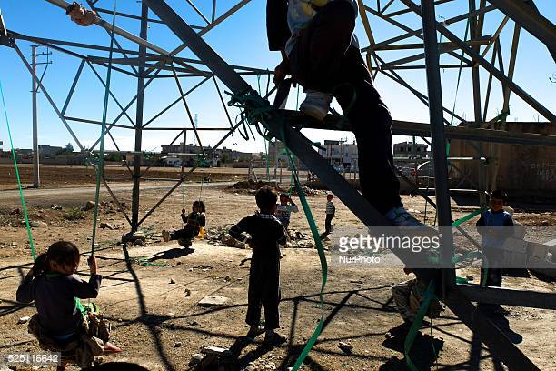 Kurds refugee children play outside a refugge camp in the Turkish city of Suruc Sanliurfa province wich is located 6 kilometres far from the Syrian...