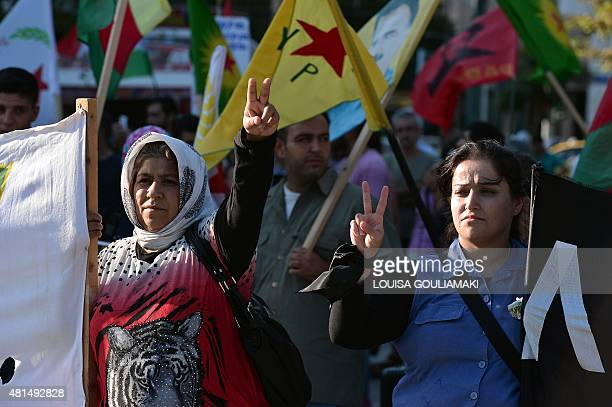 Kurds residing in Greece make victory signs as they march towards the Turkish embassy in Athens on July 21 2015 to protest against the suicide...