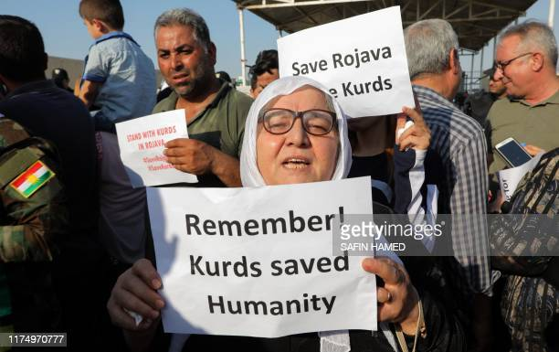 Kurds take part in a demonstration in Arbil the capital of the northern Iraqi Kurdish autonomous region on October 10 2019 against the Turkish...