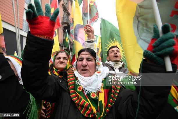 TOPSHOT Kurds wave flags and banners of convicted Kurdistan Worker's Party leader Abdullah Ocalan during a demonstration by several thousand people...