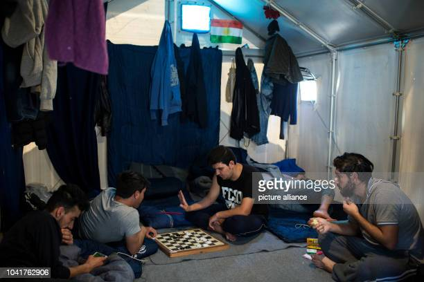 Kuridish Refugees playing a board game in their tent at the Souda refugee camp on the island of Chios Greece 27 April 2017 Some 3700 refugees and...