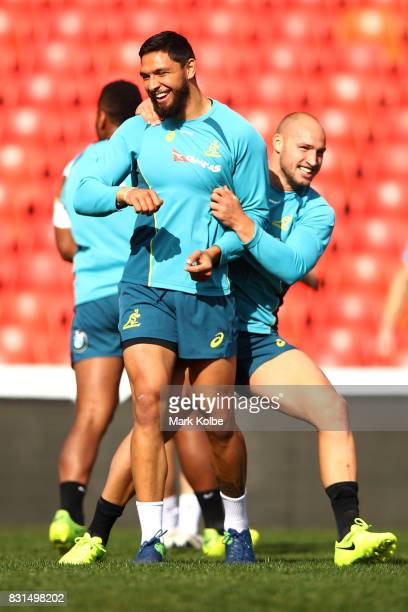 Kuris Rona and Bill Meakes share a joke during an Australian Wallabies training session at Pepper Stadium on August 15 2017 in Sydney Australia