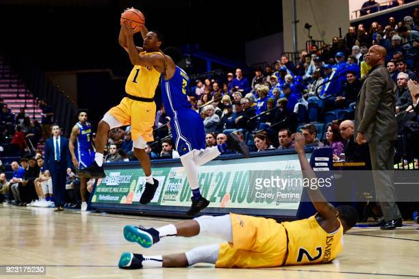 Kurk Lee of the Drexel Dragons steals a pass intended for Anthony Mosley of the Delaware Fightin Blue Hens as Tramaine Isabell of the Drexel Dragons...